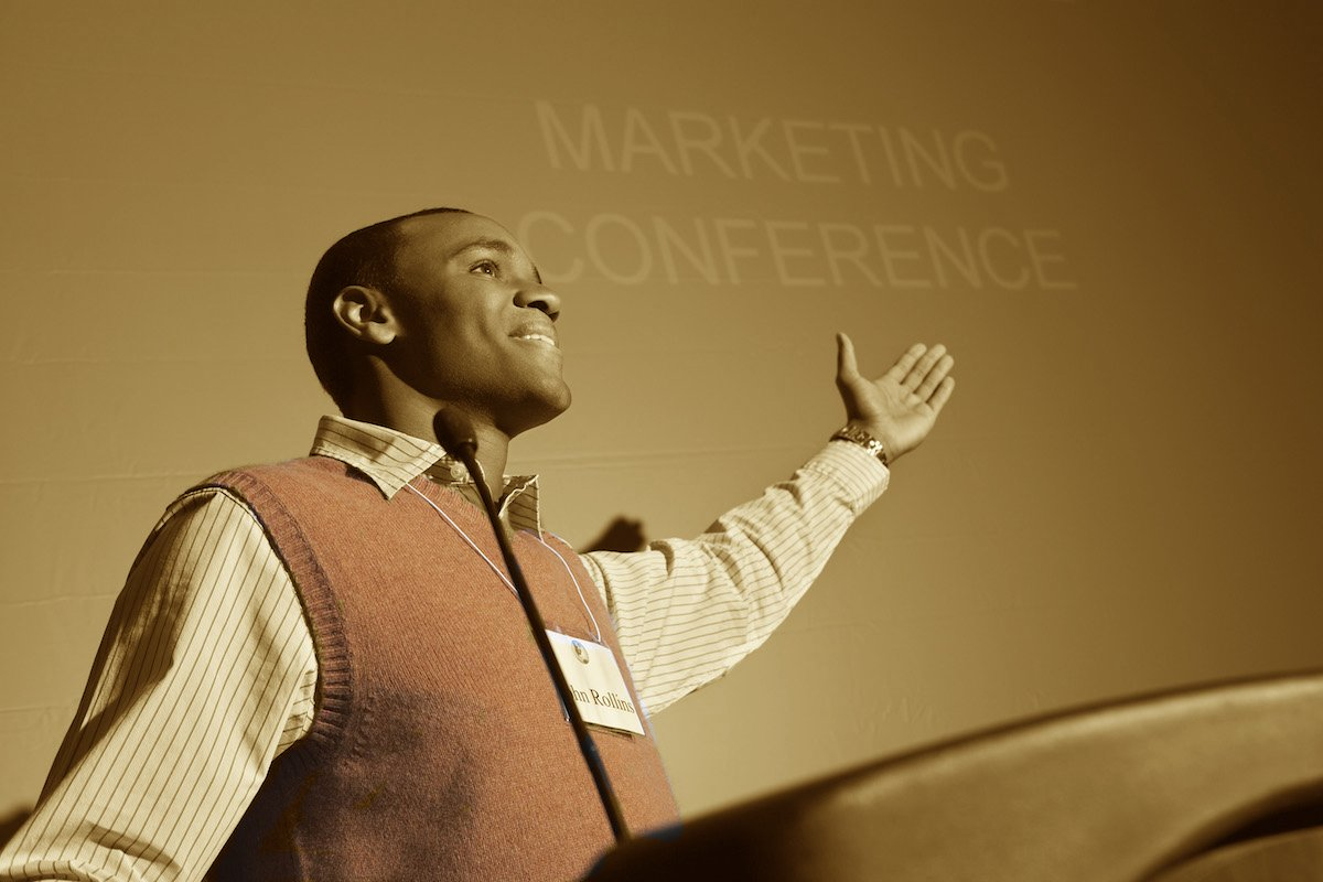 business development time savers have a networking strategy low angle view of an african american businessman giving a speech on podium