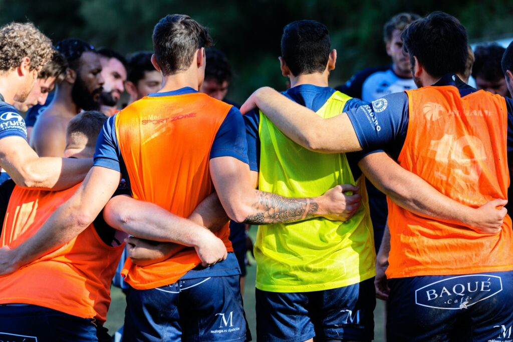 a football team huddle to represent becoming a member of the club as a key step to making partner