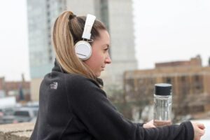 girl with headphones to symbolise listening when saying no to clients