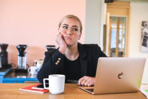 a woman thinking about how to say no to law firm clients