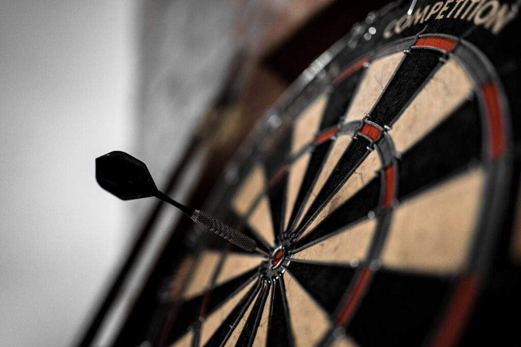 a dart in a bullseye to symbolize how to improve your tender win rate