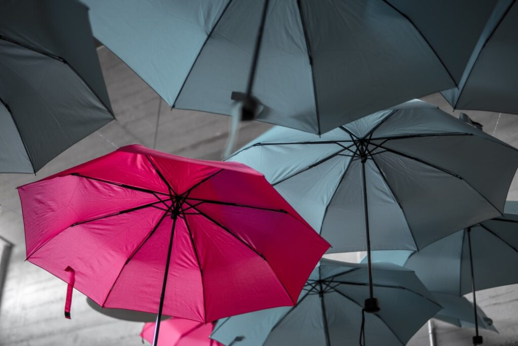 tips for pitching so that you can stand out like this red umbrella among a number of grey ones