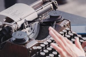 a typewriter to symbolise writing stories as one of the top job hunting tips