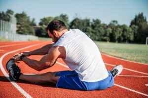 a runner stretching to represent not preparing for the partnership admissions process