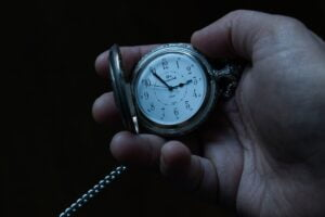 a pocket watch to symbolise not starting early enough to prepare for the partnership process