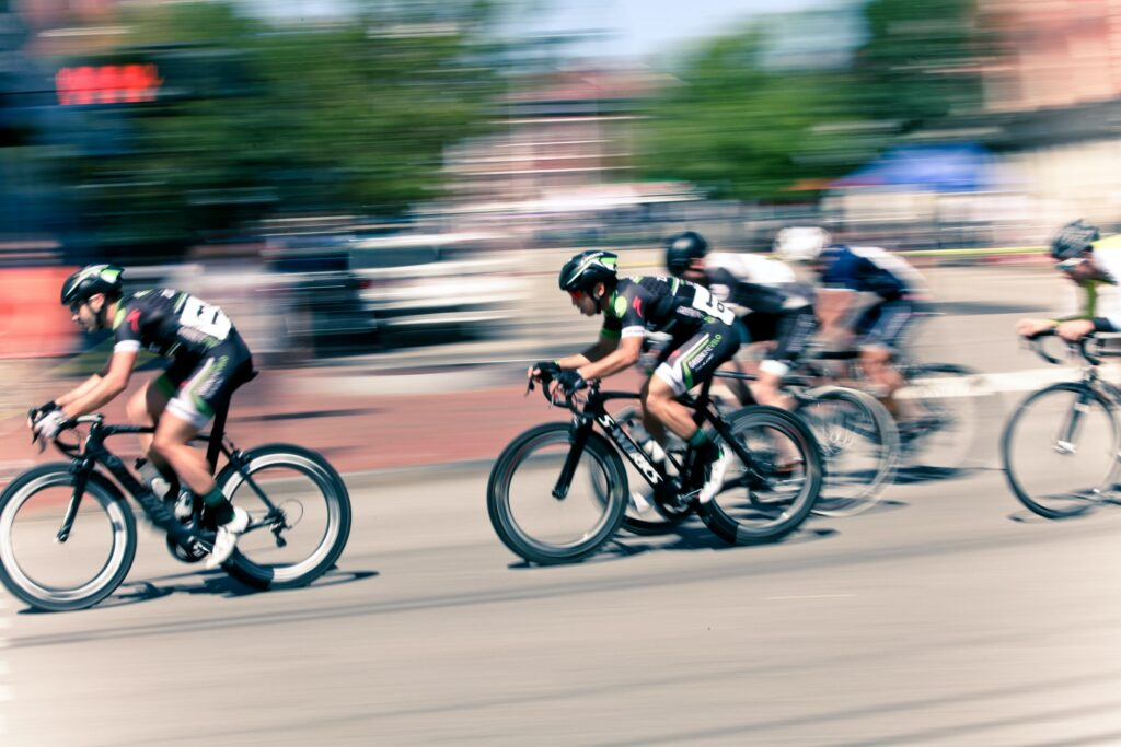 a blurred image of cyclists racing to represent a productive first day back to work