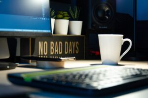 a sign on a desk saying no bad days to represent being productive on your first day back to work