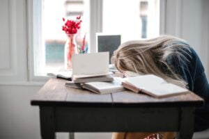 a woman asleep at her desk to symbolise why you need to prepare your virtual team for the long haul
