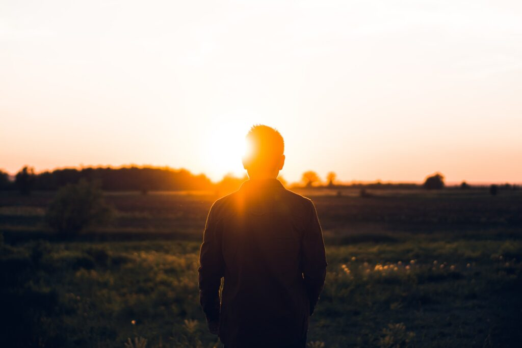 a man watching the sun rise to symbolise preparing for partnership early