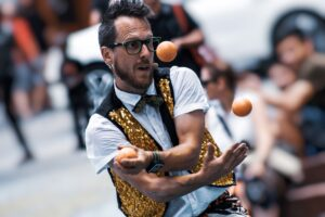 a man juggling to represent managing your career to move it forward