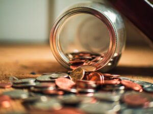 money spilling out a jar to represent the rewards of becoming a big four partner