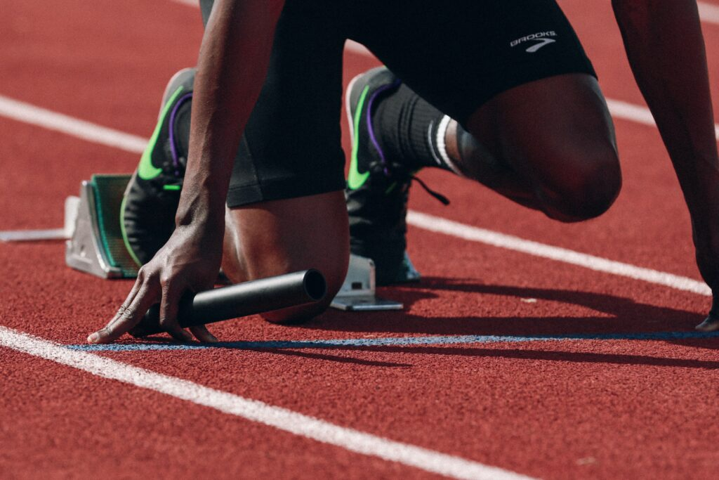 a runner at the starting block to represent what you need to do to make partner