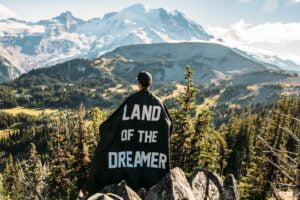 a man with a cape saying 'land of the dreamer'