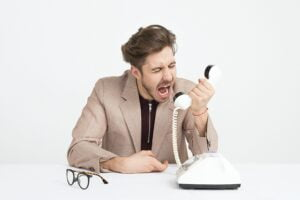 a man shouting down the phone to symbolise how to embrace change using emotional intelligence