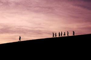 a group following a leader to represent how to embrace change in the workplace